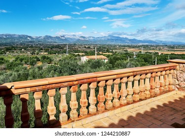 Valley with Mountain range and surrounding countryside, view from balcony with balustrade fence. Majorca, Spain