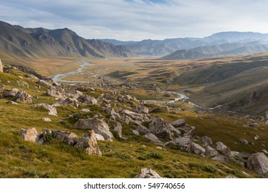 Valley of the mountain river among meadows with dry yellow grass on the highland steppe near Mongolia, Plateau Ukok, Altai, Siberia, Russia