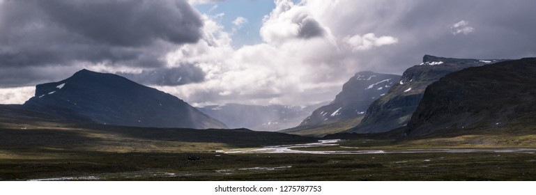 Valley and mountains at Kungsleden trail (Kings path) in northern Sweden during rain.