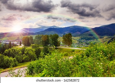 valley near forest on a steep mountain slope after the rain in morning mood