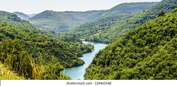 The valley of the Tarn river between Millau and Albi (Aveyron, Midi-Pyrenees, France) at summer