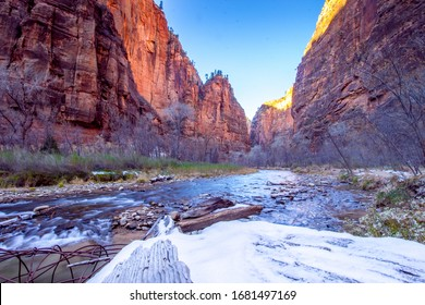 Valley in Zion National Park, ZNP, NPS . A semi-frozen river running through Zion National Park located in Utah. Red rocks and ice during the winter season.