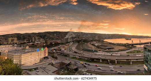 VALPARAISO, CHILE - April 24, 2017: building on fire downtown Valparaiso as the city just experience a 6.9 earthquake on Richter scale during an outer world sunset