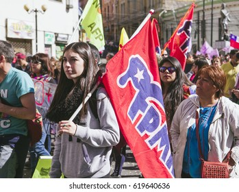 """Valparaiso, Chile - August 21, 2016: A young woman carries a FPMR flag, """"Frente Patriotico Manuel Rodriguez"""" (Manuel Rodriguez Patriotic Front) during a march against pension system."""