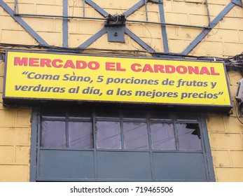 """Valparaiso, Chile - Circa February 2012: Sign of Mercado El Cardonal in Valparaiso - phrase """"Eat healthy, 5 portions of fruits and vegetables per day at the best prices"""" written in Spanish"""