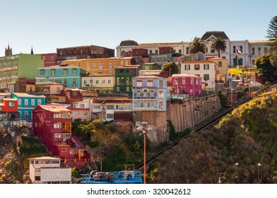 VALPARAISO, CHILE - DECEMBER 3: National Maritime Museum of Chile in the background and funicular on the front at December 3, 2012. Valparaiso colorful houses on the hill.