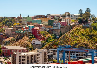 VALPARAISO, CHILE - DECEMBER 3: Two cars of Funicular in Valparaiso, Chile against background of colorful houses in Cerro Artilleria at December 3, 2012.