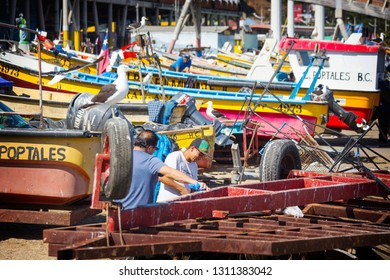 VALPARAISO, CHILE - February 2019: People working on the fish market in Valparaiso, Chile. Fisherman cutting fresh fish on the market, Chile, South America
