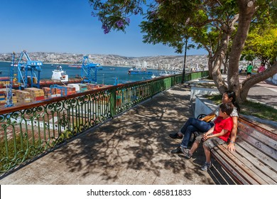 Valparaiso, Chile, January 11, 2017:  Tourists looking at view on the port of Valparaiso from Paseo Artilleria.