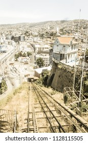 VALPARAISO, CHILE - JANUARY 2, 2018: Cityscape of Valparaiso city from Artilleria funicular, Chile. The colorful houses and hectic street in Valparaiso. Image with vintage and yesteryear effect.