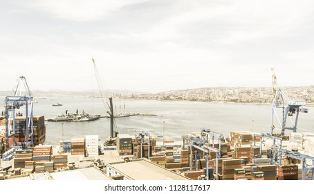 VALPARAISO, CHILE- JANUARY 2, 2018: The busy cargo seaport in South America in Valparaiso, Chile. It is the most important seaport in Chile. Image with vintage and yesteryear effect