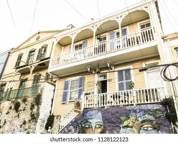 VALPARAISO, CHILE - JANUARY 2, 2018: House covered under colorful graffiti in Valparaiso, Chile, the second city of Chile. Image with vintage and yesteryear effect