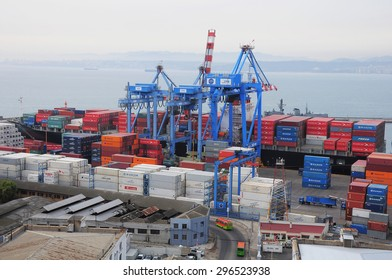 Valparaiso, Chile - May 30, 2013: Loading of the container vessel in the city port.