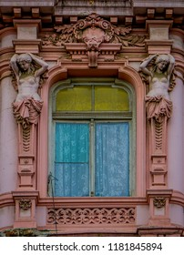 VALPARAISO, CHILE - SEPTEMBER, 15, 2018: Outdoor view of carved facade of a rose building located in Valparaiso dowtown