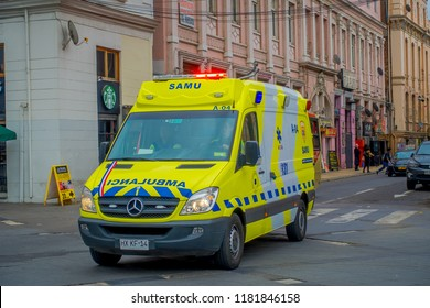VALPARAISO, CHILE - SEPTEMBER, 15, 2018: Outdoor view of yellow ambulance circulating over the streets of Valparaiso Chile