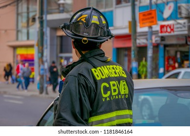 VALPARAISO, CHILE - SEPTEMBER, 15, 2018: Outdoor back view of unidentified man wearing a firefighter suit in the streets of Valparaiso Chile