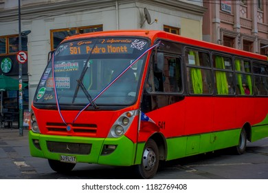 VALPARAISO, CHILE - SEPTEMBER, 15, 2018: Outdoor view of bus circulating over the streets of Valparaiso Chile