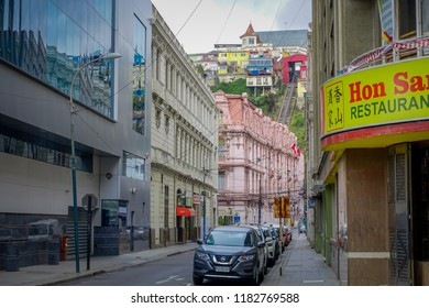 VALPARAISO, CHILE - SEPTEMBER, 15, 2018: Outdoor view of Traffic street with cars circulating on Valparaiso, surrounding of old buildings