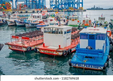 VALPARAISO, CHILE - SEPTEMBER, 15, 2018: Outdoor view of many boats and cranes docked in a harbor of Valparaiso