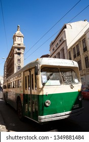 VALPARAISO-CHILE, FEBRUARY 05, 2014:Old trolley on a street in Valparaiso in front of watch Turri building in Valparaiso, Chile on February 2, 2014