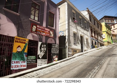VALPARAISO-FEBRUARY 5, 2014: Houses on Cerro Concepcion with a graffiti of President Salvador Allende, Victor Jara and Chavez in Valparaiso historic World Heritage of UNESCO, Chile on February 5, 2014
