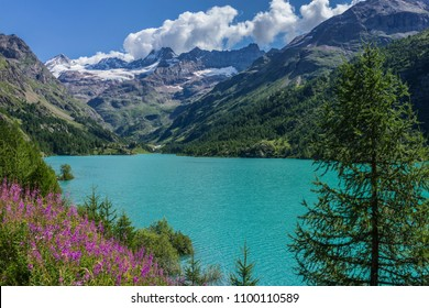 Valpelline, Aosta Valley, Italy. Artificial lake of Place Moulin, with Tete de Valpelline, Dent d'Herens and Grandes Murailles in the background, near the border with Switzerland.