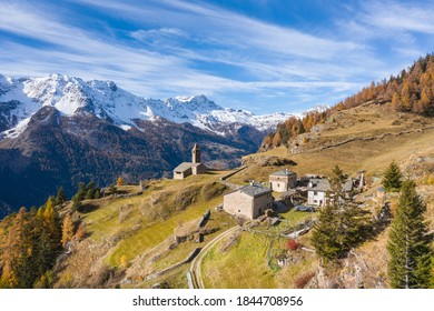 Valposchiavo, pasture of San Romerio with little huts and church