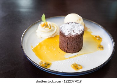 Valrhona chocolate moelleux or molten cake with passion fruit served on plate