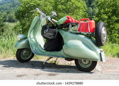 Valsesia, Italy - June 30, 2019: Classic motorbike, a vintage Italian Vespa Piaggio during a meeting for historic vehicles.