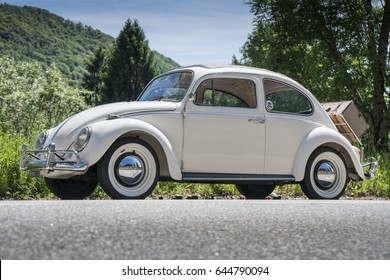 VALSESIA / ITALY - MAY 21, 2017: a vintage german motor car Volkswagen Beetle parked on a mountain road