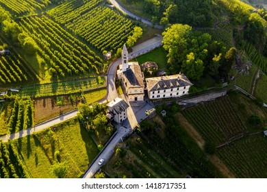 Valtellina (IT) - Castionetto di Chiuro - Aerial view of the vineyards and little church