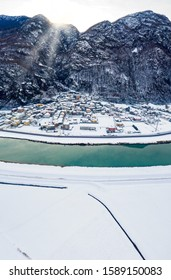 Valtellina (IT) - Panoramic aerial view of the Adda river and the Sirta village in winter
