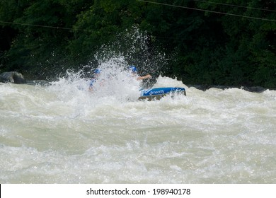 VALTELLINA, ITALY - 11 JUNE 2014: An athlete participates in the ICF Wildwater Canoeing World Championships, 11 June 2014 on River Adda in Valtellina (Italy)