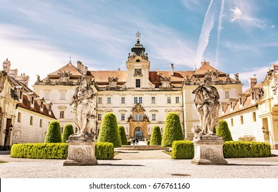 Valtice contains one of the most impressive baroque residences of central Europe. Architectural scene. Travel destination. Yellow photo filter.