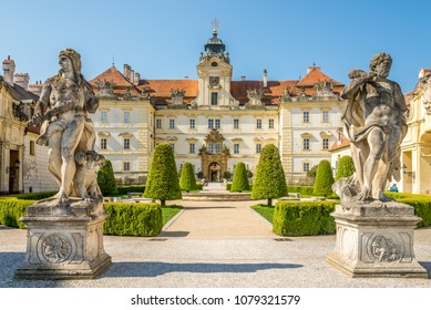 VALTICE, CZECH REPUBLIC - APRIL 19,2018 - View at the Valtice castle with statues. The town Valtice was founded in the 13th century.