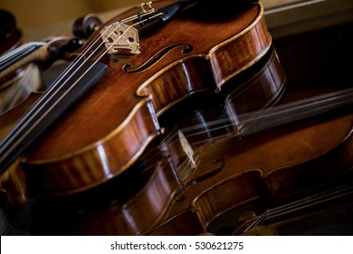 valuable violin on glass table