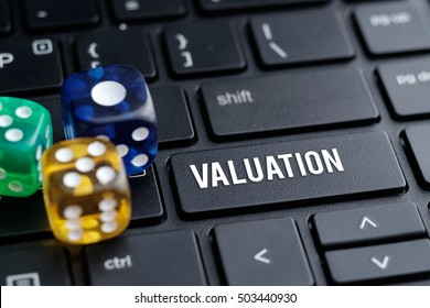 Valuation, dice, keyboard. Business concept.
