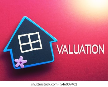 VALUATION written on red background with wooden house