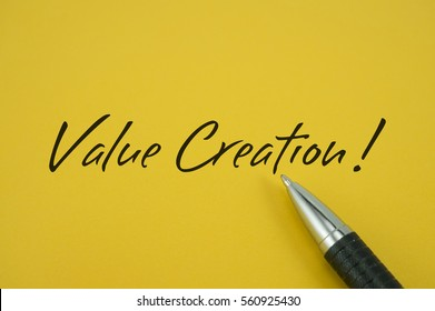 Value Creation! note with pen on yellow background
