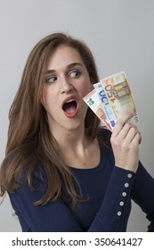 value for money concept - astonished 20s woman holding Euro bills having more financial ambition or in economic frustration,studio shot