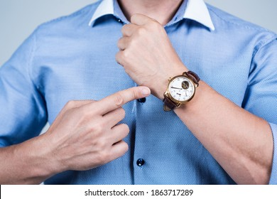 Value your time. Manager cropped view point finger at wrist watch. Time management. Meeting deadline. Punctuality and promptness. Business appointment. Fashion accessory.