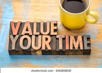 value your time - word abstract in vintage letterpress printing blocks with a cup of coffee