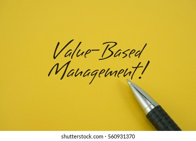 Value-Based Management! note with pen on yellow background