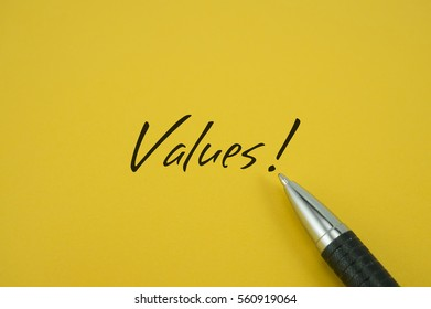 Values! note with pen on yellow background