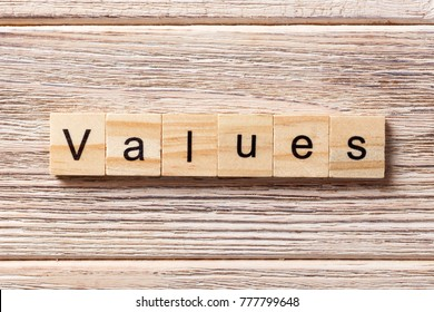 values word written on wood block. values text on table, concept.