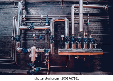 The valves and pipes at a craft modern brewery wall