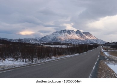 VALVIKA, NORDLAND COUNTY / NORWAY - FEBRUARY 03 2019:  Winter view on mountains in Norway.  Winter road near Valvika settlement