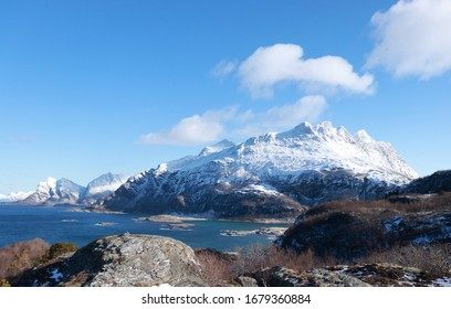 VALVIKA, NORDLAND COUNTY / NORWAY - MARCH 20 2020: View from the Hovden mountain to the Mjellefjellet - Litltinden, Mjelletinden, Breitinden mountain peaks