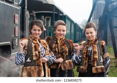Vama, Bucovina, Romania, October 18 2014: Mocanita is a narrow-gauge railway in Bucovina, nowadays being rehabilitated for tourism purposes. Image of traditional  costumed Romanian locals.