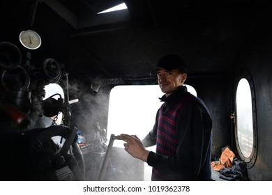 Vama, Romania, October 27, 2017: Steam train conductor
